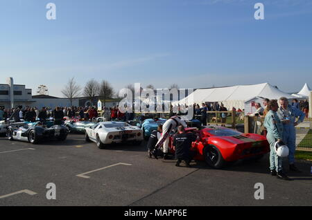 Original Ford GT40 race cars line up at the 2014 Goodwood Revival held each September at the West Sussex motor racing circuit. - Stock Photo