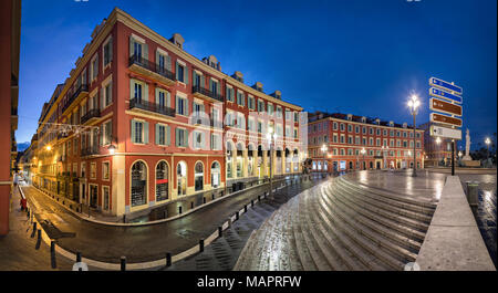 Place Massena square with red buildings at dusk in Nice, France - Stock Photo