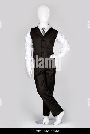 Single Child mannequin dressed in kids wear, isolated on  gray background - Stock Photo