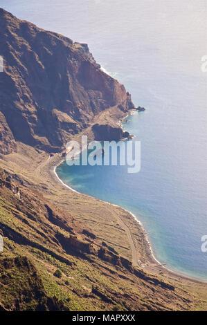 Panoramic view of Las Playas Bay, including Roque Bonanza islet, from the Mirador de las Playas overlook in El Hierro, Canary Islands, Spain - Stock Photo