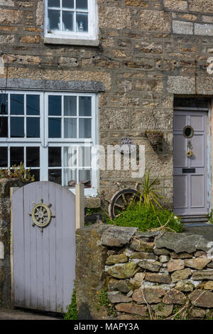 The front aspect of a typically Cornish old stone built cottage or house in a terrace in st Ives or saint Ives in cornwall with nautical decorations. - Stock Photo
