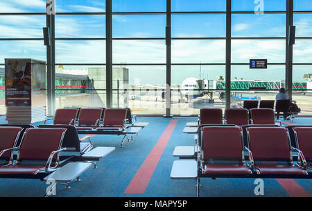 Buenos Aires, Argentina - March 23th, 2018: Boarding gates of the terminal C of the Ministro Pistarini International Airport with a plane and jetways  - Stock Photo