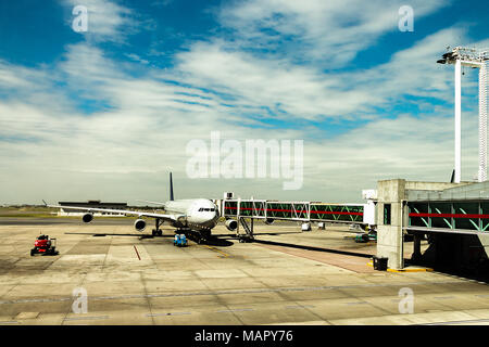 A jet airplane at the jetway finger, ready for pushback at Ministro Pistarini Ezeiza International Airport in Buenos Aires, Argentina. - Stock Photo