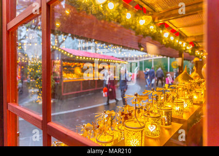 Christmas Market Stalls and shoppers in Leicester Square, London, England, United Kingdom, Europe - Stock Photo