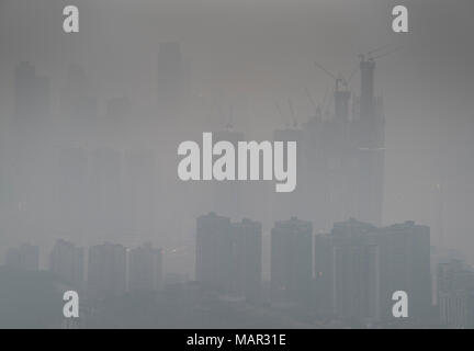 Skyline in heavy fog of the city of Chongqing under construction, Chongqing, China, Asia - Stock Photo