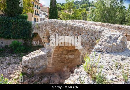 Old Roman double arch stone bridge, Pollenca, Mallorca (Majorca), Balearic Islands, Spain, Europe - Stock Photo