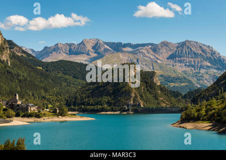 Lanuza village, resevoir and dam and the Tendenera mountains, Tena Valley, Sallent de Gallego, Pyrenees, Huesca Province, Spain, Europe - Stock Photo