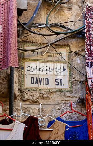 goods for sale from the stalls in david st in the old city of jerusalem - Stock Photo