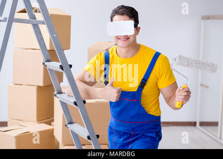Painter contractor working with virtual reality goggles - Stock Photo