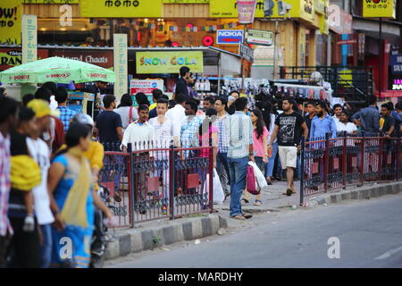 Bangalore, India - October 16, 2016: Moving crowd in the evening rush hour at Brigade Road. Brigade road is one of the busiest place in the city. - Stock Photo