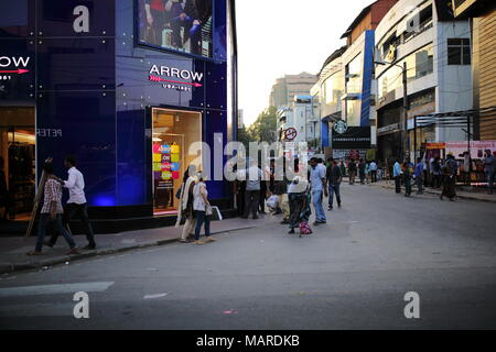 Bangalore, India - October 16, 2016: Moving crowd in the evening rush hour at Brigade Road, Bangalore. - Stock Photo