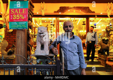 Bangalore, India - October 16, 2016: Unknown old man standing in front of his shop at MG Road, Bangalore. - Stock Photo