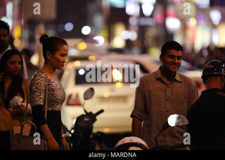 Bangalore, India - October 16, 2016: Unknown people in a friendly conversation at MG Road, Bangalore. - Stock Photo