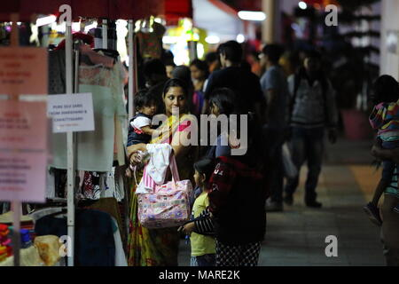 Bangalore, India - October 16, 2016: Unknown people busy in shopping apparels this evening at MG Road, Bangalore. - Stock Photo