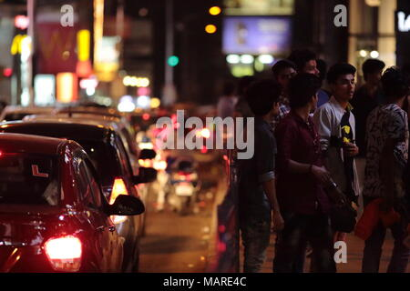 Bangalore, India - October 16, 2016: Night scene of moving traffic and crowd in the peak hours at Brigade Road, Bangalore. - Stock Photo