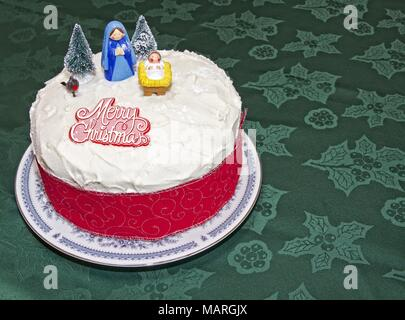 Cake Decorated With Christmas Trees And Merry Christmas Written In Icing Stock Photo Alamy