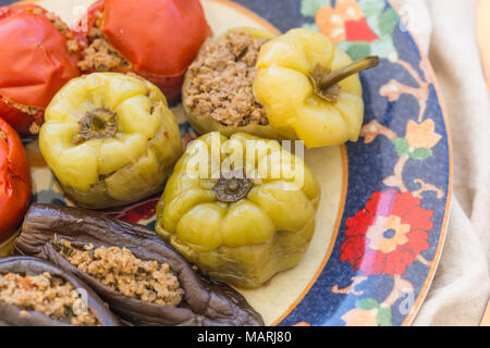 Closeup shot of meat stuffed tomatoes, peppers and eggplant served. Horizontal composition. - Stock Photo