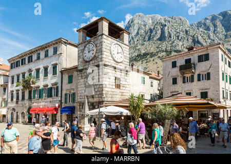 KOTOR, MONTENEGRO - september 25, 2016: People walking on Square of Arm at Kampana clock tower in the old town of Kotor, Montenegro. - Stock Photo