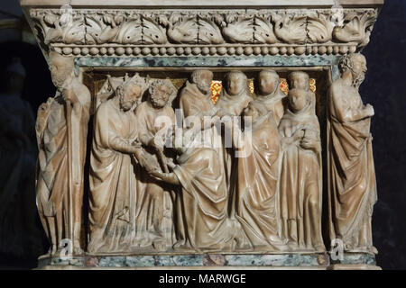 Miracles of Saint Dominic depicted in the marble relief carved by Italian Early Renaissance sculptor Nicola Pisano and his assistants Lapo di Ricevuto and Arnolfo di Cambio (1267) on the Arca di San Domenico (Shrine of Saint Dominic) in the Basilica of San Domenico (Basilica di San Domenico) in Bologna, Emilia-Romagna, Italy. The Apostles Peter and Paul appear to Saint Dominic, while he was praying in the basilica of Saint Peter in Rome, and give him the staff and the Book as the symbols of the Apostolic mission. The Saint sends his followers out on their mission to preach in the world. - Stock Photo