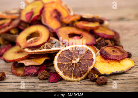 Close Up Of Pile Of Organic Raw Sun Dried Fruits Mix Of Oranges, Plum, Strawberries, Golden Berries And Peach On Wooden Table Background, Healthy Natu - Stock Photo
