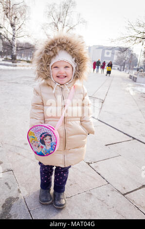 Happy two year old child wearing her fashionable winter coat, Bulgaria - Stock Photo