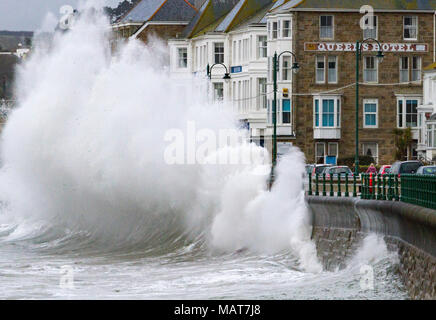 Penzance, Cornwall, UK. 4th April 2018.  A fast moving late winter storm brings waves as high as three storey hotels to the south west coast as Britain struggles to move properly in to Spring. Credit Mike Newman/Alamy Live News - Stock Photo