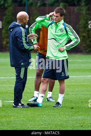 FILE: 4th April, 2018: Ray Wilkins passes away. Photo taken: Cobham, UK. 29th Sep, 2010. Ray Wilkins encourages a young Josh McCreachan during training at Cobham prior to the second round of CHAMPIONS LEAGUE against MARSEILLES FC  Sept 2010 Credit: Motofoto/Alamy Live News - Stock Photo