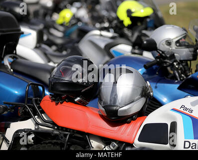 26 March 2018, Germany, Wuppertal: Motor helmets lie on top of motorcycles. North Rhine-Westphalia's Interior Minister Herbert Reul of the Christian Democratic Union (CDU) promotes greater safety measures at the beginning of the motorcycling season. Photo: Oliver Berg/dpa - Stock Photo