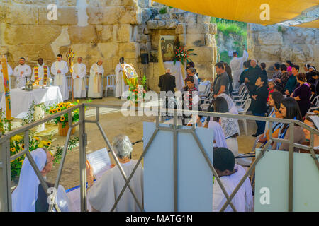 EMMAUS, ISRAEL - APRIL 2, 2018: Easter Monday Solemn Mass at the basilica of Emmaus-Nicopolis, with priests and prayers, Israel. Commemorating Jesus r - Stock Photo