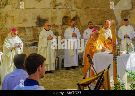 EMMAUS, ISRAEL - APRIL 2, 2018: Easter Monday Solemn Mass at the basilica of Emmaus-Nicopolis, with the Latin Patriarch of Jerusalem and other priests - Stock Photo