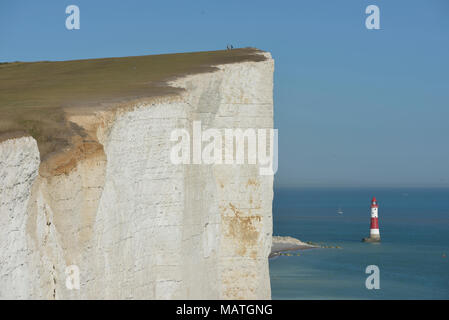 Beachy head lighthouse viewed from South Downs Way on top of the Seven Sisters cliffs, East Sussex, England, UK - Stock Photo