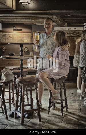 A couple inside The Tiger Inn, East Dean, East Sussex, England, UK - Stock Photo