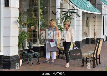 Two women shopping, Eastbourne, East Sussex, England, UK - Stock Photo