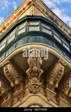 Gargoyle Under The Balcony Of The Grandmaster`s Palace gargoyles of Valletta, Malta, Europe - Stock Photo