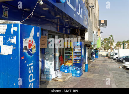 Aqaba, Jordan, March 3, 2018: Small general store that placed its beverage warehouse on the street, in the side street of a suburb of Aqaba, middle ea - Stock Photo