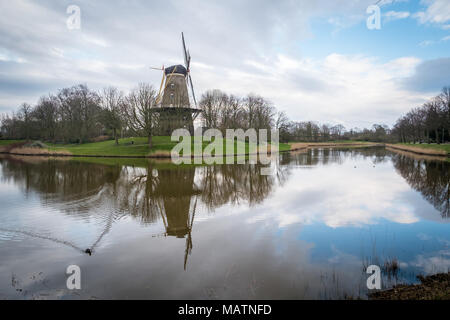 Sunset over a canal and windmill just outside Middelburg, the Netherlands, in spring. - Stock Photo
