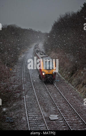 A Virgin Trains west coast voyager train in a snow storm at  Gateside (north of Sanquhar, Glasgow & South Western line, Scotland) - Stock Photo