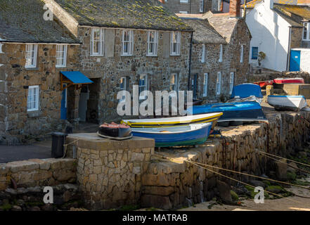 fishermans cottages alongside the harbour wall in Mousehole, Cornwall. old cornish cottages and fishing boats in traditional cornish village. Harbours - Stock Photo