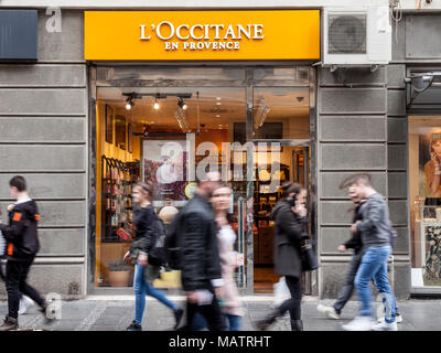 BELGRADE, SERBIA - MARCH 31, 2018: L'Occitane en Provence logo on their shop of Belgrade, people passing by. This brand is the most known Southern Fra - Stock Photo