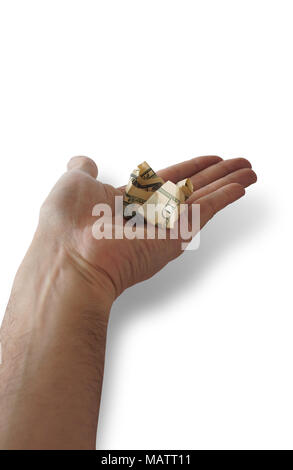 10 dollar bill crumpled on the palm of a man's hand on white background. Save selection included - Stock Photo