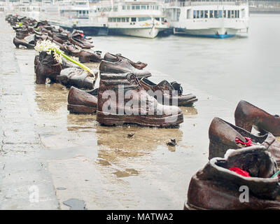 BUDAPEST, HUNGARY-MARCH 31, 2018: Shoes on the Danube Bank memorial by Can Togay and Gyula Pauer - Stock Photo