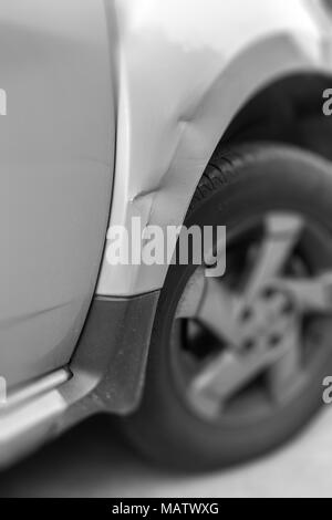 Dents on the car caused by the accident. Shallow depth of field. - Stock Photo