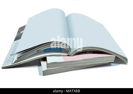 Opened blank pages of magazine or book, catalog on Stack of thick magazines isolated on a white background - a mock up for demonstrating your design - Stock Photo
