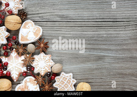 Gingerbread cookies and spices on the old wooden background - Stock Photo