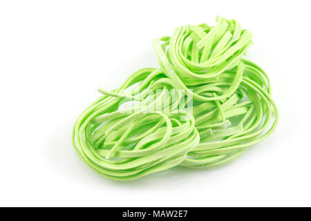 Instant noodles, green noodles, vegetable noodles  isolated on white background - Stock Photo