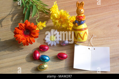 Easter concept. Happy Easter day with eggs, greeting card, flowers and rabbit ceramic on wood table with Copy space. - Stock Photo