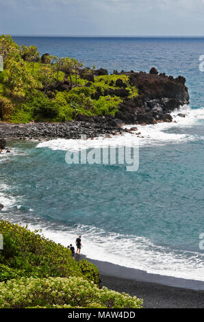 Honokalani Black Sand Beach located in the Wainapanapa State Park, Hana, Maui Hawaii - Stock Photo