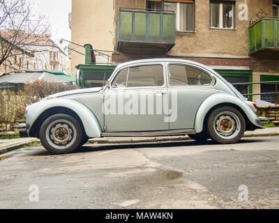 BUDAPEST, HUNGARY-MARCH 31, 2018: Silver Volkswagen Beetle (Type 1) in the city streets - Stock Photo