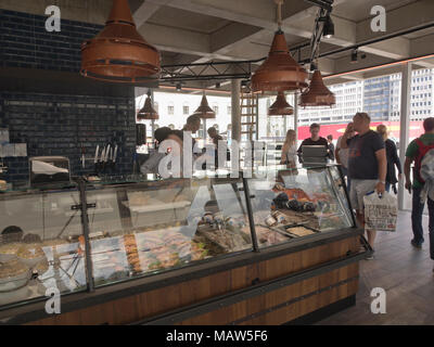 Fish and seafood market with restaurant opened at Aker Brygge in Oslo Norway in 2017, wide selection also with prepared food in the counters - Stock Photo
