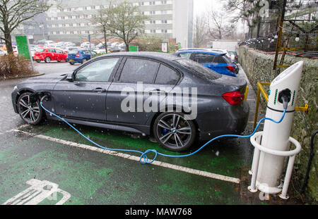 Electric car re charging at an Ever Warm electric charging station, Edinburgh UK